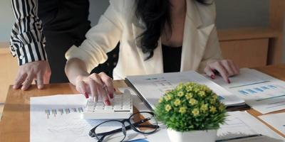 Two business professionals looking over paperwork photo