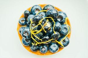 Sweet dessert with blueberry tart in white plate photo