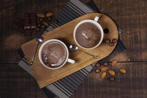 Hot chocolate with almonds, top view photo