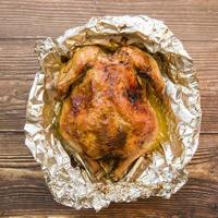 Baked chicken on foil photo