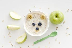 Bowl with oat flakes and fruits photo