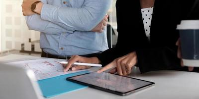 Professional using a tablet in a meeting photo