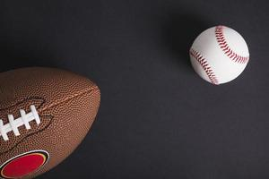 Brown rugby ball and baseball on black background photo