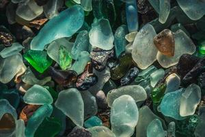 Close-up of colorful sea glass on sand in Vladivostok, Russia