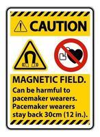 precaución, el campo magnético puede ser perjudicial para los usuarios de marcapasos. vector