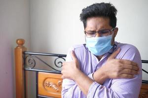 Sick man wearing a protective mask photo