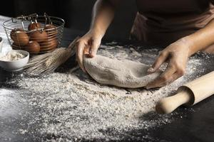 Chef preparing dough with rolling pin photo