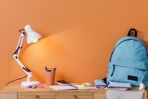 Children desk interior design with orange wall photo