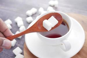 Sugar cubes and coffee photo