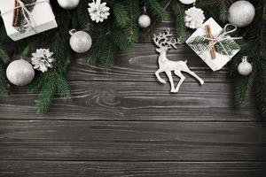 Christmas composition green fir tree branches with small deer photo
