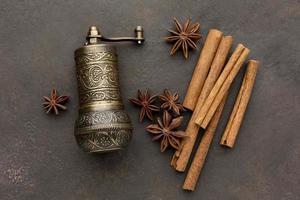 Cinnamon sticks and grinder photo