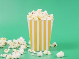 Close-up of delicious popcorn on green background photo