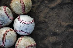 Close-up dirty baseballs with copy space photo