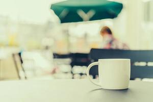 Coffee cup on the table photo