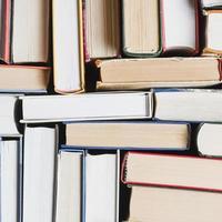 Close-up of randomly stacked books photo