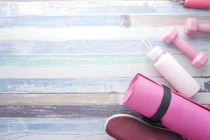 Pink workout set on wood photo