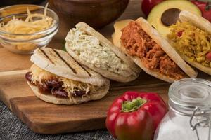 Delicious arepas on wooden board photo
