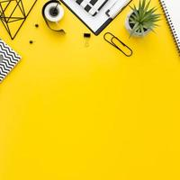 Yellow desk with office supplies photo