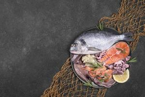 Exotic seafood dish plate over fish net photo