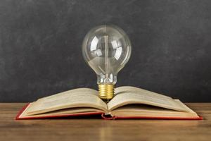Arrangement with book and light bulb photo
