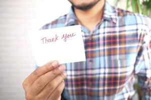 Man holding a thank you note photo