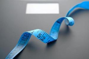 Measuring tape on a scale photo