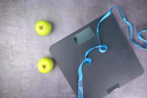 Apples with a measuring tape and scale photo