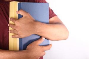 Man holding books photo