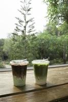 Glasses of green iced sweet milk drink photo