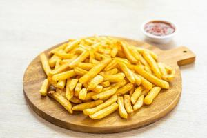 French fries with tomato or ketchup sauce