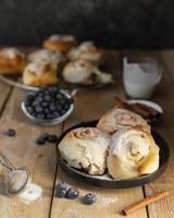 Cinnamon rolls and blueberries high angle photo