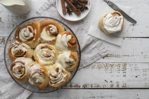 Cinnamon rolls with cream top view photo