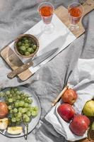 Composition of delicious picnic goodies on a blanket photo