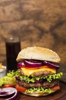 Close-up burger on wooden tray photo