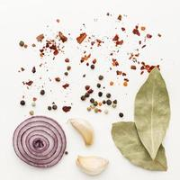 Cooking spices and ingredients on white background photo