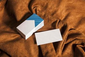 Corporate business cards on brown cloth photo
