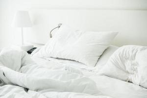 White pillow on rumpled bed photo