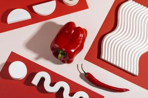 Red peppers on red and white modern background photo
