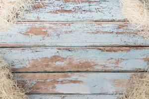 Decorative straw on rustic wooden table photo