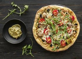 Pizza with pesto and arugula photo
