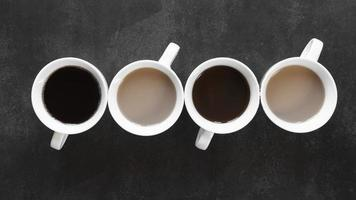 Cups of coffee on table photo