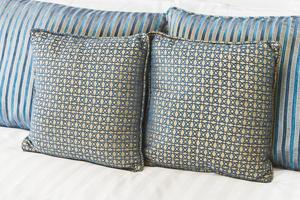 Bed pillows in hotel bedroom photo