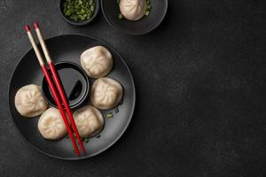 Flat lay Asian dumplings with chopsticks and copy space photo