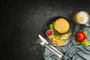 Flat lay burger and fries on plate with copyspace photo