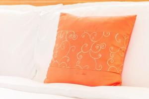 Beautiful luxury bedroom interior with orange pillow photo