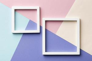 Flat lay frames on colorful background photo
