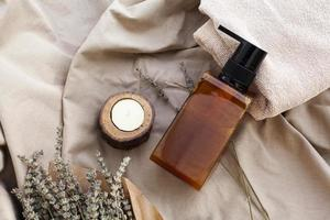 Flat lay essential oil bottle on plain background photo