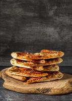 Front view of a stack of pizza photo