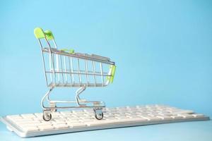 Shopping cart on keyboard photo