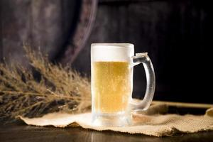 Beer jar with blurred tree branch photo
